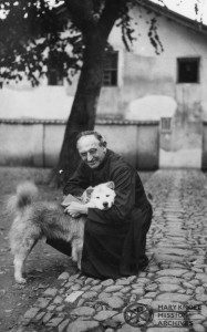 Fr Downs with his dog, Meixien, China, 1935