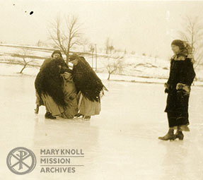 Several Sisters help Sr. Gemma Shea up from a tumble on the ice rink at The Venard, Clark's Summit, PA, 1925