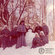 Maryknoll Novices in Topsfield, MA build a snowman, 1962