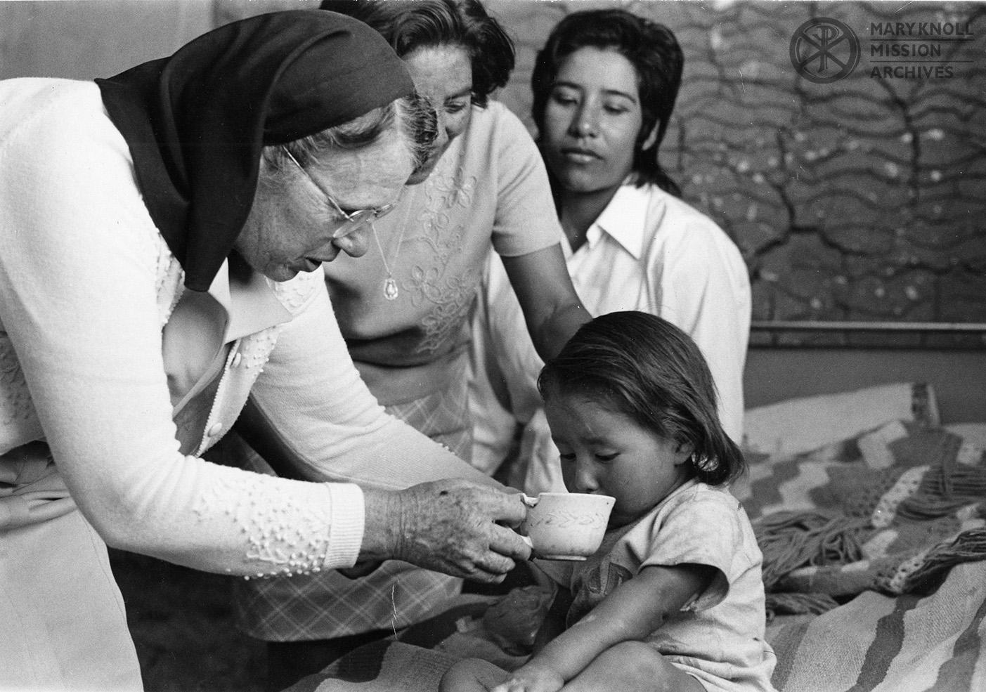 Sister Elizabeth Ann Altman with a child, Bolivia