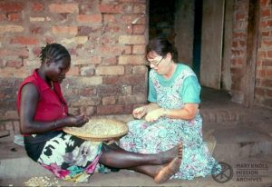 Lay Missioner Liz Mach preparing food with a refugee in Sudan