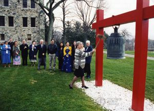 Lay missioner Vicki Simon strikes bell at Mission Sending Ceremony, 1998