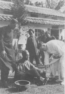 Fr. Dietz and Bro. John helping patients at the dispensary in Tungchen, 1925