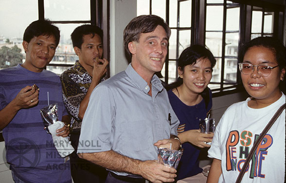 Fr. Edward Shellito with students in the Philippines