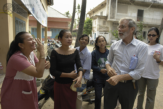 Father Charlie Dittmeier communicating with deaf people in sign language, Cambodia, 2006