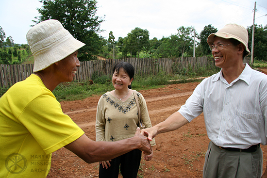 Tawny Thanh meeting with a local pastor, Cambodia, 2005