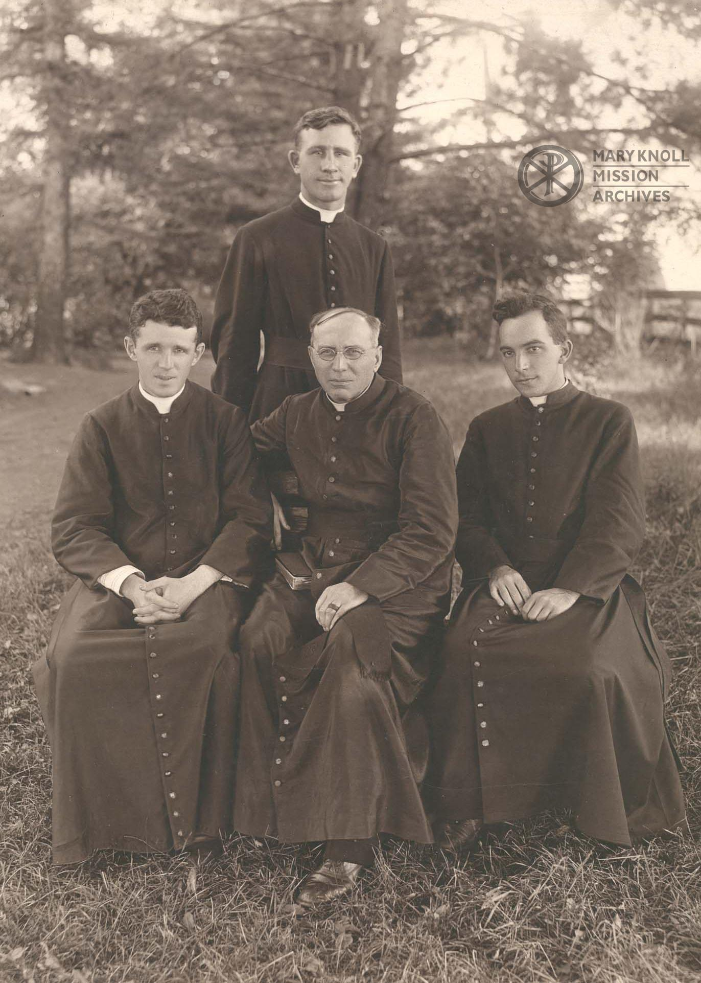 Fr. James Edward Walsh, Fr. Bernard Meyer (standing), Fr. Thomas Frederick Price, and Fr. Francis X. Ford