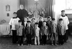 Fr. Leo Tibesar with children at their First Communion, Minidoka Internment Camp