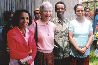 Sr. Dorothy McGowan with health promoters Filomena, Manuel Beremau, and Rosita Quintao