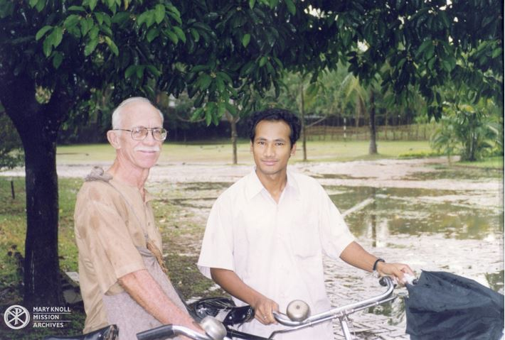 Fr. Bob McCahill with friend Bidya Barman and their bicycles, 1999