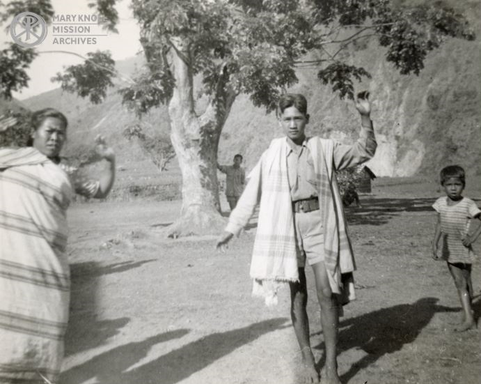 A man and woman dance during the fiesta wearing special dancing robes, 1949