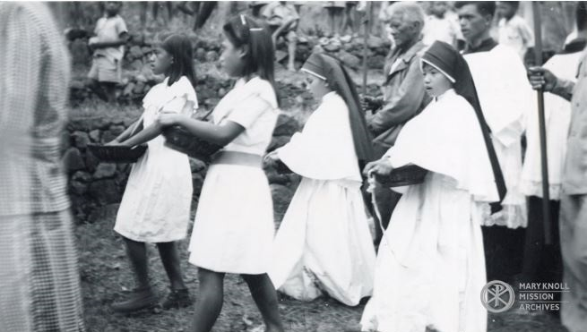 Girls participate in the procession as part of the fiesta, 1949