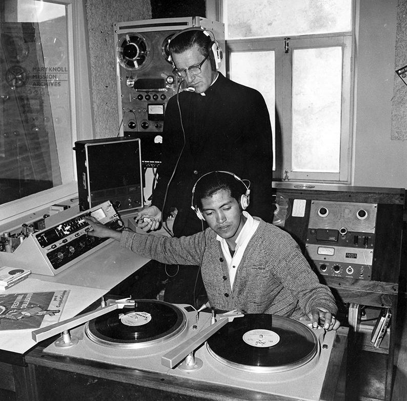Fr. Leo Sommer working with a Radio San Rafael employee